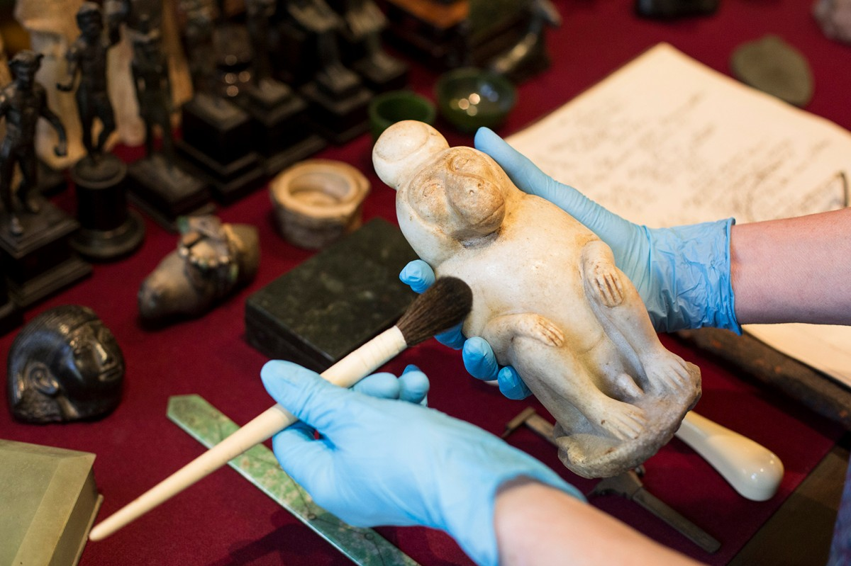 Baboon of Thoth in the hands of conservator | museum photography | © Freud Museum London